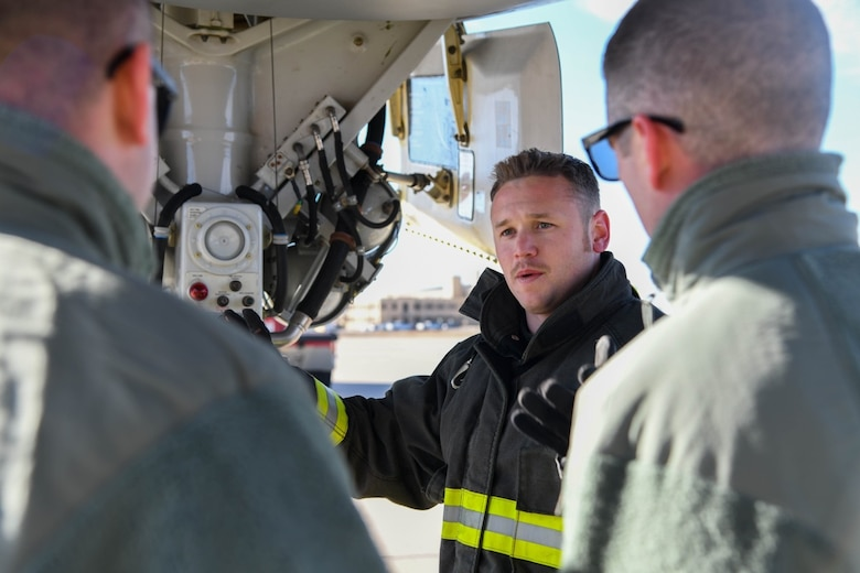 William Turner, 22nd Civil Engineering Squadron fire fighter, displays the auxiliary power unit fuel shut-off on the backside of the front landing gear Nov. 13, 2019 at McConnell Air Force, Kan. Participants in the KC-46 Firefighter Symposium had the opportunity to tour the interior and exterior of the aircraft as part of the live-demonstration training. (U.S. Air Force photo by Airman 1st Class Nilsa E. Garcia)