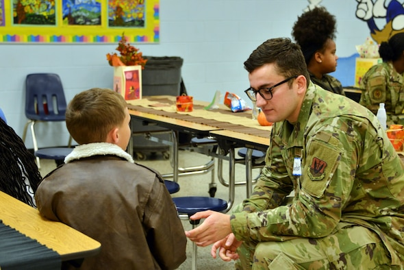 Staff Sgt. Zachary Perez, 101st Air and Space Operations Group intelligence analyst at Tyndall Air Force Base, Florida, attended a Thanksgiving holiday lunch at Northside Elementary School in Panama City, Florida, Nov. 21, 2019. Team Tyndall members helped serve food and also engaged with children whose families were not able to attend the event. Team Tyndall members donate hundreds of hours of volunteer work each year to help support the local community. (U.S. Air Force photo by 2nd Lt. Kayla Fitzgerald)