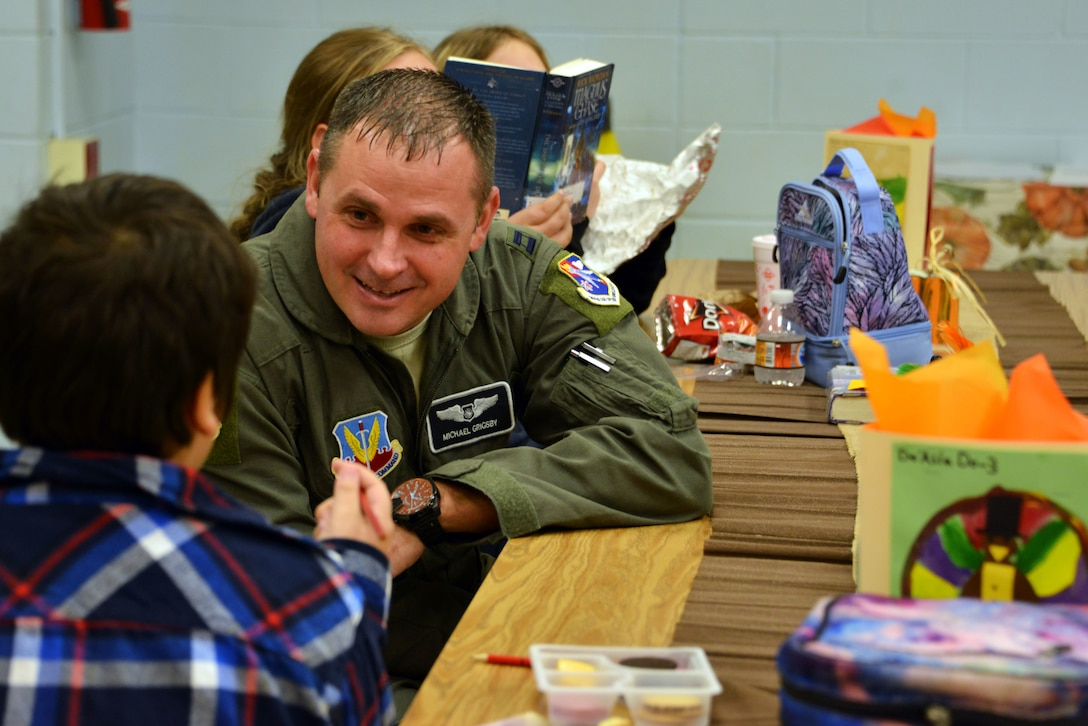 Capt. Michael Grigsby, 601st Air Operations Center strategic planner at Tyndall Air Force Base, Florida, attended a Thanksgiving holiday lunch at Northside Elementary School in Panama City, Florida, Nov. 21, 2019. Team Tyndall members helped serve food and also engaged with children whose families were not able to attend the event. Team Tyndall members donate hundreds of hours of volunteer work each year to help support the local community. (U.S. Air Force photo by 2nd Lt. Kayla Fitzgerald)