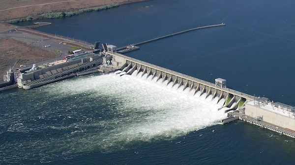 Spill through two raised spillway weirs (right) and conventional spillways at McNary Dam on the lower Columbia River improves downstream passage survival for juvenile salmon and steelhead.
