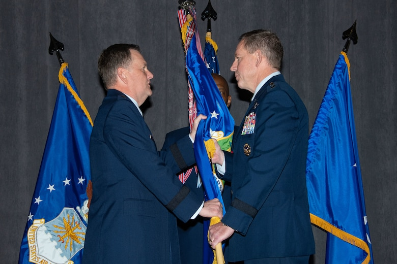 Lt. Gen. Brad Webb, commander of Air Education and Training Command, passes the guidon to Lt. Gen. James B. Hecker during an assumption of command ceremony in which Hecker takes over as the commander and president of Air University Nov. 22, 2019, at Maxwell Air Force Base, Alabama. The AU provides full spectrum education, research and outreach at every level through professional military education, professional continuing education and academic degree granting.