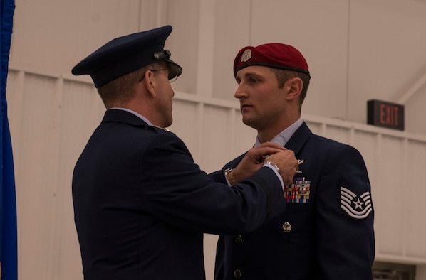Lt. Gen. Jim Slife, left, commander of Air Force Special Operations Command, presents a Silver Star Medal to Tech. Sgt. Cody Smith, a special tactics combat controller with the 26th Special Tactics Squadron, during a ceremony at Cannon Air Force Base, N.M., Nov. 22, 2019. Smith was awarded the nation's third highest medal against an armed enemy of the United States in combat for his actions while deployed to Afghanistan in October 2018. (U.S. Air Force photo by Senior Airman Rachel Williams)