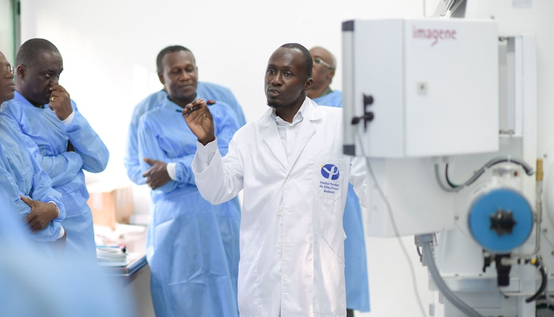 A member of the Pasteur Institute Lab gives a tour of the facility for participants of the African Partner Outbreak Response Alliance in Abidjan, Côte d'Ivoire, Nov. 20, 2019.