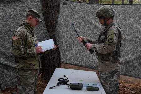 U.S. Army Capt. David Morin, a network officer with the 93rd Signal Brigade, begins the task to transmit a spot report during the Expert Soldier Badge course at Joint Base Langley-Eustis, Virginia, Nov. 18, 2019. The ESB allows a Soldier to demonstrate a high level of competence and ability to perform to-standard Skill Level I Warrior Tasks and brigade commander-selected tasks. (U.S. Air Force photo by Senior Airman Derek Seifert)