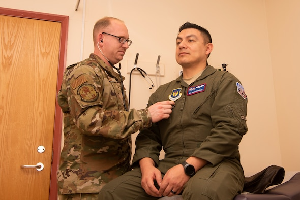 Staff Sgt. Zachary Gandy, 48th Aerospace Medicine Squadron flight operations medical technician, listens to the heartbeat of Senior Airman David Rodriquez, 351st Air Refueling Squadron boom operator, Nov. 19, 2019, at RAF Mildenhall, England. The clinic provides treatment to flyers so they are able to safely perform their in-air responsibilities. (U.S. Air Force photo by Airman 1st Class Joseph Barron)
