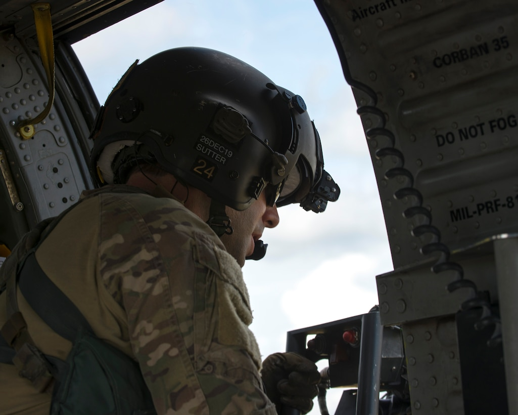 U.S. Air Force Reserve Master Sgt. Jeremy Sutter, a special missions aviator assigned to the 305th Rescue Squadron (RQS), Davis-Monthan Air Force Base, Ariz., operates an HH-60 Pave Hawk helicopter's .50-caliber weapon over Avon Park Air Force Range, Fla., Nov. 8, 2019.