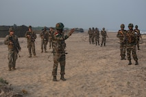 U.S. Marines and Indian Soldiers conduct patrol drills during exercise Tiger TRIUMPH in Kakinada Beach, India on November 19, 2019. The drills were to teach U.S. Marines and Indian Soldiers how each country patrols and use hand signals. Tiger TRIUMPH gives U.S. and Indian forces the opportunity to exchange knowledge and learn from each other as well as establish personal and professional relationships. The Marines are with 3rd Marine Division, III Marine Expeditionary Force. (U.S. Marine Corps photo by Lance Cpl. Armando Elizalde)