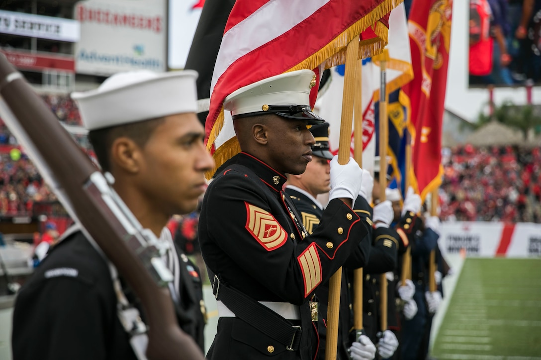 U.S. Central Command's Color Guard line the field during halftime of the Tampa Bay Buccaneers Salute to Service game vs. the New Orleans Saints, Nov. 17, 2019 at Raymond James Stadium. (U.S. Marine Corps photo by Sgt. Roderick Jacquote)