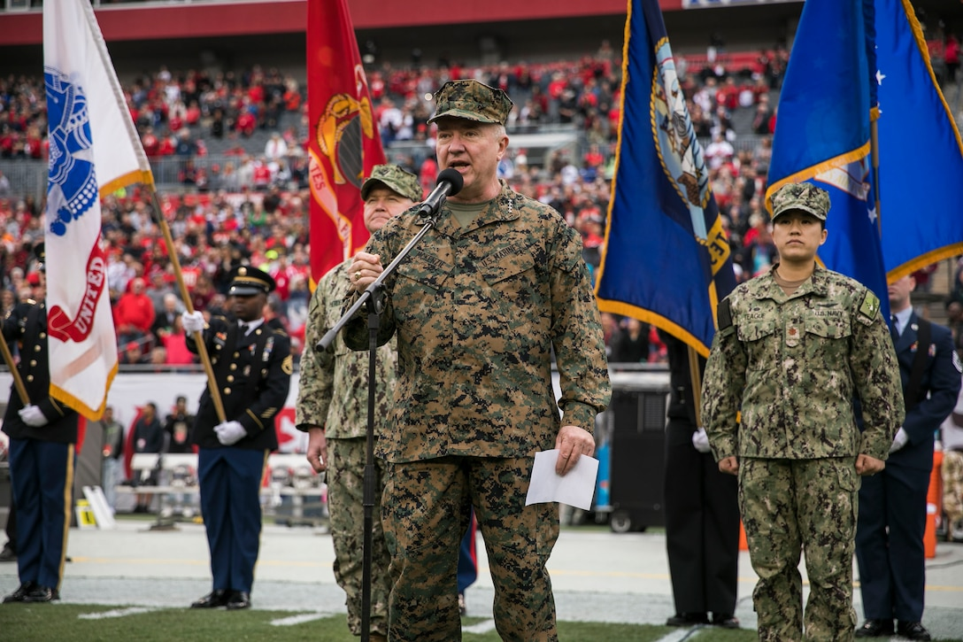 U.S. Marine Corps Gen. Kenneth F. McKenzie, Jr., commander, U.S. Central Command, reads the Oath of Enlistment to 189 new recruits from all military service branches during halftime of the Tampa Bay Buccaneers Salute to Service game vs. the New Orleans Saints, Nov. 17, 2019 at Raymond James Stadium. (U.S. Marine Corps photo by Sgt. Roderick Jacquote)