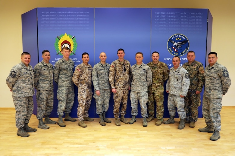 Members of the Michigan Air National Guard and the Latvian Air Force pose for a photo Nov. 15, 2019 after a planning meeting at Lielvārde Air Base, Latvia, to chart cooperation under the National Guard Bureau's State Partnership Program over the coming year (Michigan National Guard Photo by Staff Sgt. Andrew Schumann).