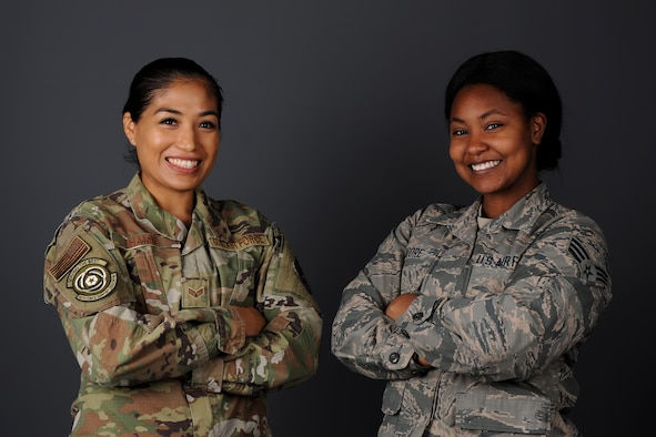Senior Airman Gladiola Hamid, 48th Force Support Squadron unit deployment manager, left, and Senior Airman Gabrielle Moore, 48th FSS military postal clerk, right, pose for photo at Royal Air Force Lakenheath, England, Nov. 18, 2018. Hamid and Moore provided rescue aid to Spanish civilians involved in a three-car collision near the town of Mogán en-route to Gando Air Base in Gran Canaria, Spain. (U.S. Air Force photo by Airman 1st Class Rhonda Smith)