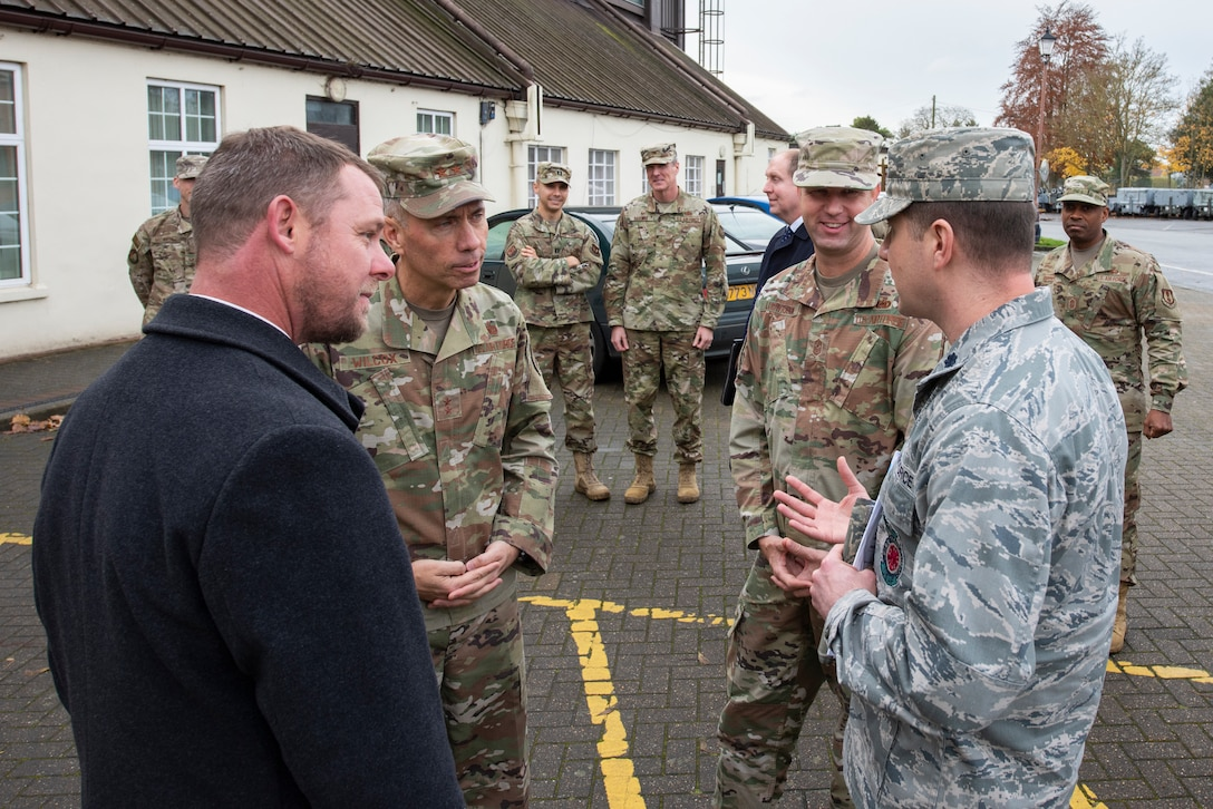 Maj. Gen. John Wilcox, Air Force Installation and Mission Support Center commander, and Chief Master Sgt. Edwin Ludwigsen, AFIMSC command chief master sergeant, speak with Airmen outside the aerospace ground equipment building Nov. 22, 2019, at RAF Mildenhall, England. The AFIMSC provides base communications, civil engineering, security forces and logistics support that assists Team Mildenhall in fulfilling its mission sets. (U.S. Air Force photo by Airman 1st Class Joseph Barron)
