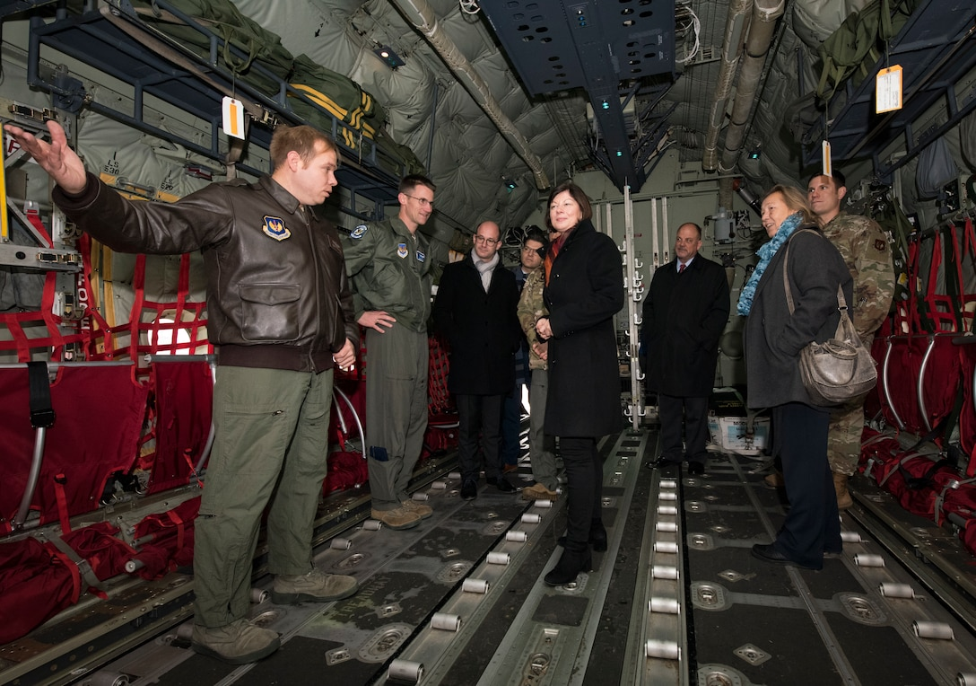 Nicole Steingaß, middle, Rheinland-Palatinate state secretary, listens as U.S. Air Force Tech. Sgt. Jonathan Hernandez, 37th Airlift Squadron loadmaster, briefs her and other German officials during a tour of a C-130J Super Hercules aircraft on Ramstein Air Base, Germany, Nov. 20, 2019. Steingaß requested the visit to get to know the base firsthand and familiarize herself with some of Ramstein's people, operations and capabilities.