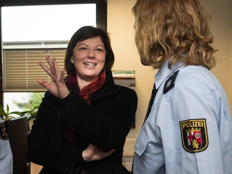 Nicole Steingaß, left, Rheinland-Palatinate state secretary, speaks with Carolyn Joas, Police Inspection Station Landstuhl police Lt., on Ramstein Air Base, Germany, Nov. 20, 2019. Steingaß received a guided tour through several stops on Ramstein, including a C-130J Super Hercules aircraft, the 721st Aerial Port Squadron Passenger Terminal, and the Sicherheitswache (German Police Station.)