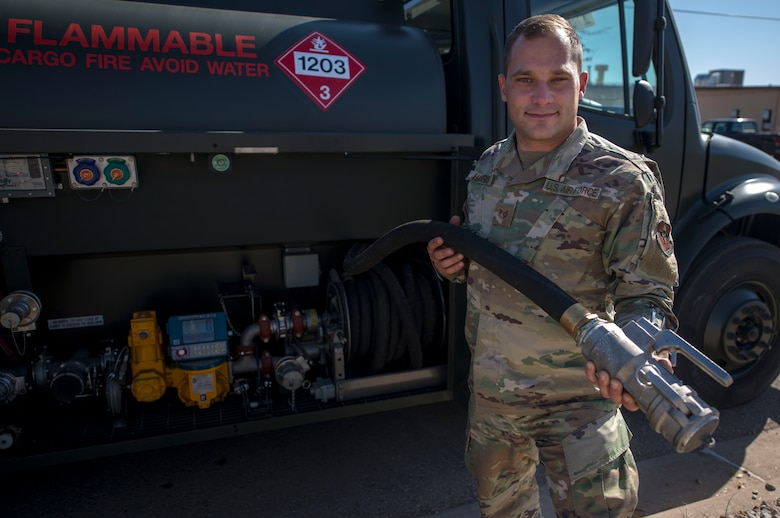 Tech. Sgt. Thomas Harris, 49th Logistics Readiness Squadron non-commissioned officer in charge of fuels distribution, holds a modified nozzle made for ground fuels, Nov. 14, 2019, on Holloman Air Force Base, N.M. The fuels distribution element recently purchased two R-13 Mobile Refueling Unit vehicles to ensure ground equipment and vehicles are getting the fuel they need. (U.S. Air Force photo by Staff Sgt. Christine Groening)