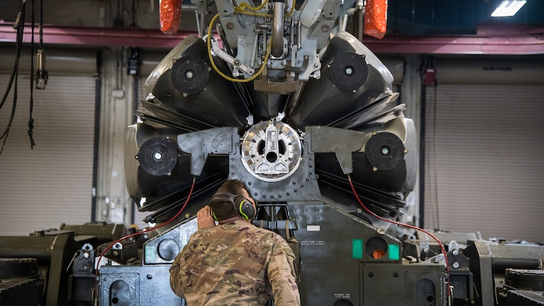 Senior Airman Ryan B. Jarvis, 2nd Munitions Squadron launcher maintenance technician, watches as the last Conventional Air-Launched Cruise Missile (CALCM) is loaded into a launcher at Barksdale Air Force Base, La., Nov. 20, 2019. The 2nd MUNS loaded the final CALCM missile package into a launcher in order to disassemble the weapon to become demilitarized. (U.S. Air Force photo by Airman 1st Class Jacob B. Wrightsman)