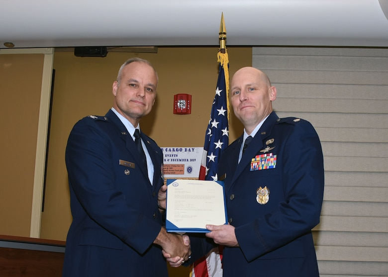 Col. Jay Miller, vice commander of the 911th Airlift Wing, poses for a photo with Col. Leland Shea during Shea's promotion ceremony at the Pittsburgh International Airport Air Reserve Station, Pennsylvania, Nov. 2, 2019.