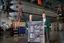Retired Cols. Trey Morriss (left) and Warren Ward (right), members of Operation Secret Squirrel, stand in front of the final Conventional Air-Launched Cruise Missile (CALCM) package at Barksdale Air Force Base, La., Nov. 20, 2019. Operation Secret Squirrel was the first time CALCM missiles were used in combat. (U.S. Air Force photo by Airman 1st Class Jacob B. Wrightsman)