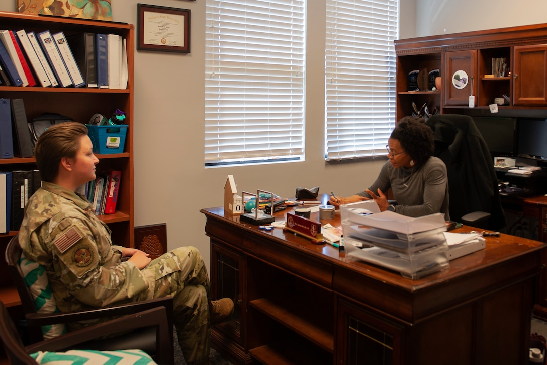 Jacinta Howell, Sexual Assault Prevention and Response (SAPR) victim advocate, talks with Airman 1st Class Brianna Warmbier, 23d Medical Group medical logistics technician, Nov. 13, 2019, at Moody Air Force Base, Ga. Howell works alongside sexual assault victims to provide them with recovery resources. The SAPR program is a wing commander's program that was put in place to support sexual assault victims through victim advocacy. (U.S. Air Force photo by Airman 1st Class Jasmine M. Barnes)