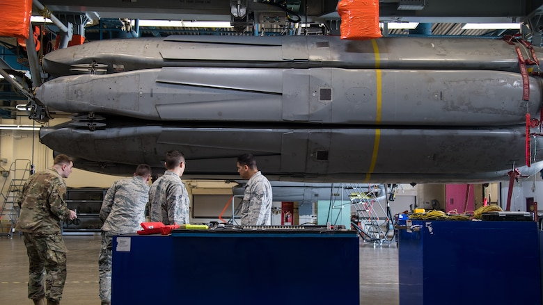 Airmen from the 2nd Munitions Squadron prepare to download the final Conventional Air-Launched Cruise Missile (CALCM) at Barksdale Air Force Base, La., Nov. 20, 2019. The 2nd MUNS loaded the final CALCM missile package into a launcher in order to disassemble the weapon to become demilitarized. (U.S. Air Force photo by Airman 1st Class Jacob B. Wrightsman)