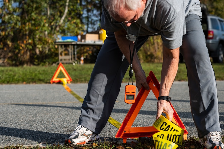 A photo of a Health and Readiness Optimization Dash 4K coordinator marks the finish line