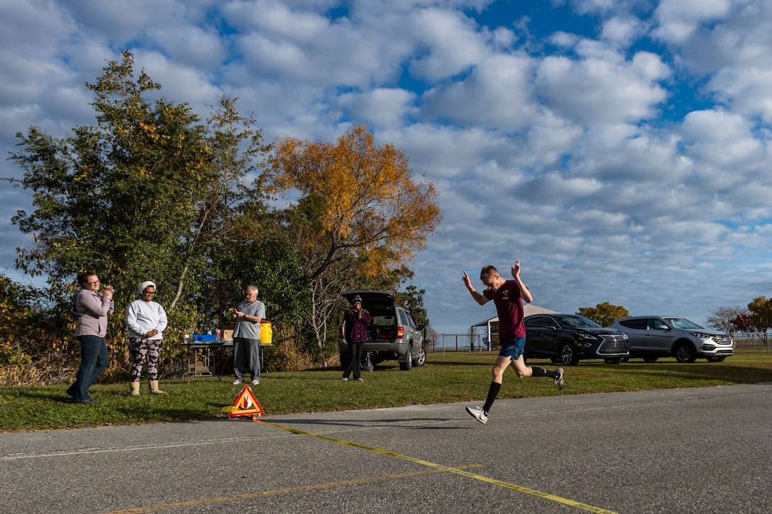 A photo of the winner of the Health and Readiness Optimization Dash 4K crossing the finish line
