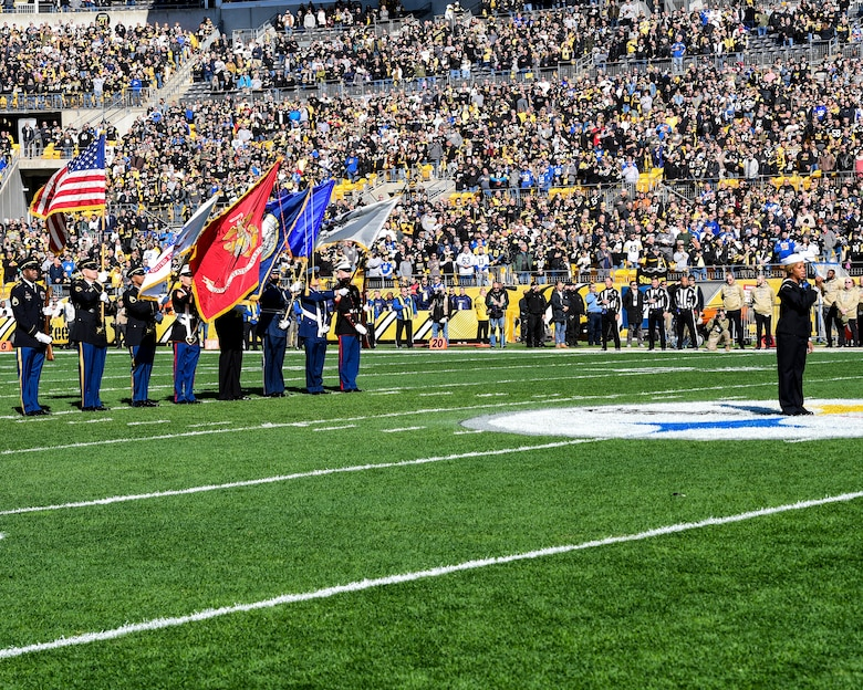 U.S. Navy Hospital Corpsman 1st Class Tanqueray Hayward performs the National Anthem with a color guard composed of members from all military branches at a Pittsburgh Steelers vs. Indianapolis Colts game at Heinz Field in Pittsburgh, Pennsylvania, November 3, 2019.