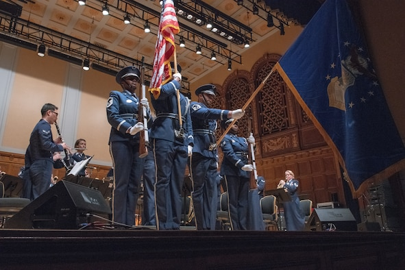 The 910th Airlift Wing base color guard presents the colors during a U.S. Air Force Heritage of America Band concert at Stambaugh Auditorium in Youngstown, Ohio, Nov. 18, 2019.