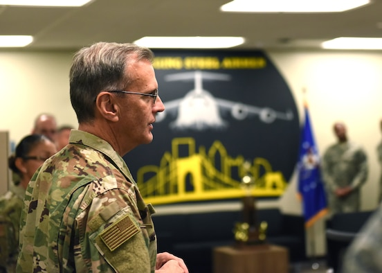 Master Sgt. Dave Vanik, 758th Airlift Squadron loadmaster, poses for a photo with Maj. Gen. Randall A. Ogden, 4th Air Force commander, and Chief Master Sgt. Cynthia Villa, 4th AF command chief, after receiving a challenge coin at the Pittsburgh International Airport Air Reserve Station, Pennsylvania, Nov. 3, 2019.