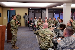 Chief Master Sgt. Cynthia Villa, 4th Air Force command chief, addresses Airmen of the 911th Airlift Wing during an all call at the Pittsburgh International Airport Air Reserve Station, Pennsylvania, Nov. 1, 2019.