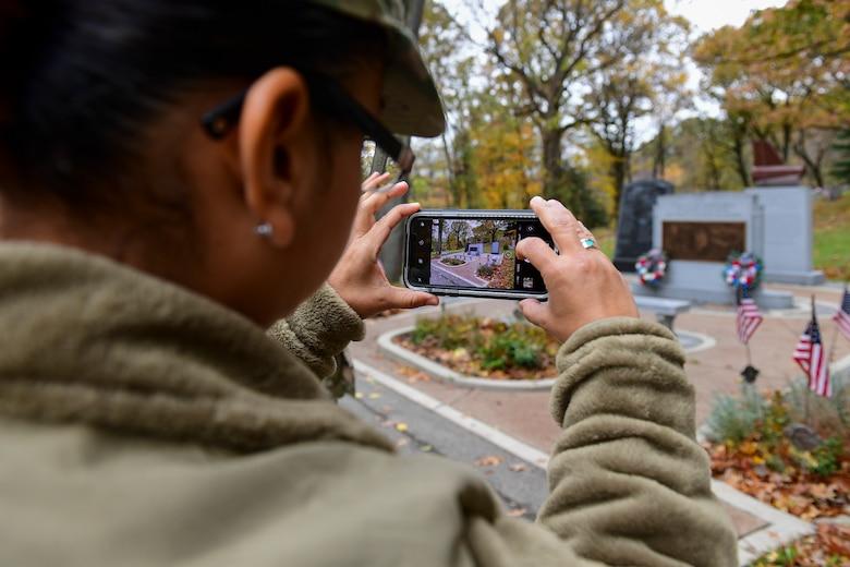 Chief Master Sgt. Cynthia Villa, 4th Air Force command chief, photographs the Tuskegee Airmen Memorial in Sewickley, Pennsylvania, Nov 1, 2019.