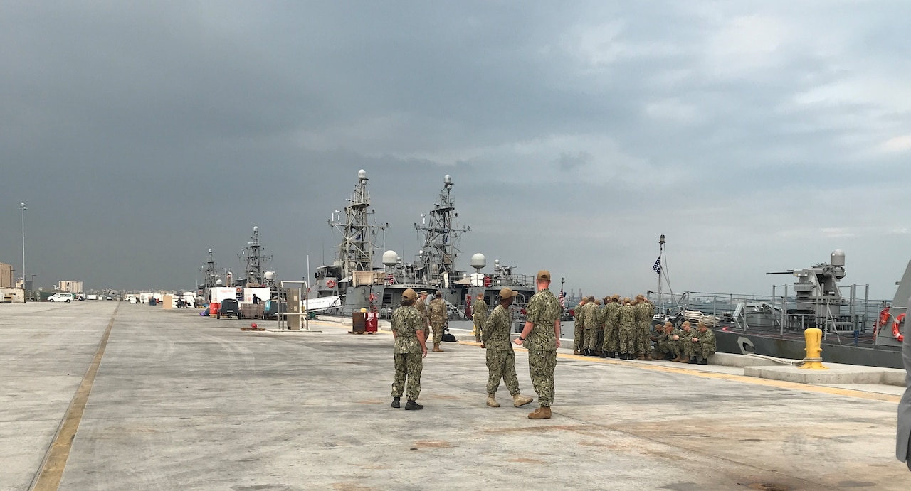 Sailors look at approaching storm.