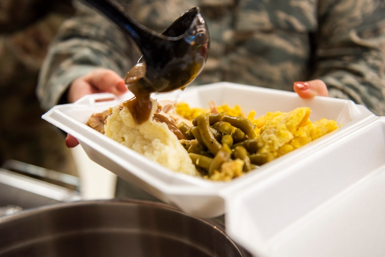 A photo of an Airman receiving food during the Annual Airman Thanksgiving Lunch
