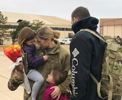 Master Sgt. Jennifer Wright, all-source intelligence analyst with the 507th Operations Support Squadron, greets her family upon returning home from a deployment to Southwest Asia Nov. 25, 2019, at Tinker Air Force Base, Oklahoma. (U.S. Air Force photo by Lauren Kelly