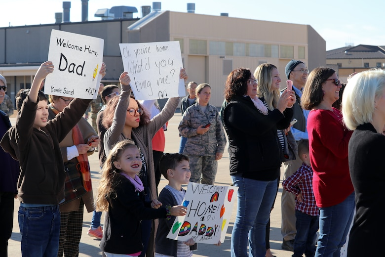 507th Air Refueling Wing families await the return of their deployed Airmen Nov. 25, 2019, at Tinker Air Force Base, Oklahoma. (U.S. Air Force photo by Senior Airman Mary Begy)