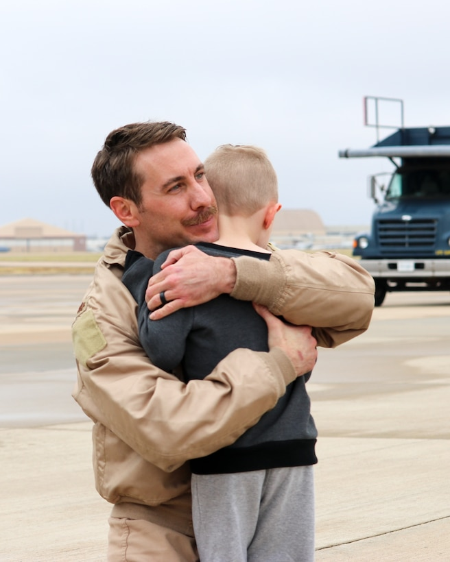 Maj. Thomas Bryceland, a KC-135R Stratotanker pilot with the 465th Air Refueling Squadron, hugs his son upon returning home from a deployment to Southwest Asia Nov. 22, 2019, at Tinker Air Force Base, Oklahoma. (U.S. Air Force photo by Senior Airman Mary Begy)