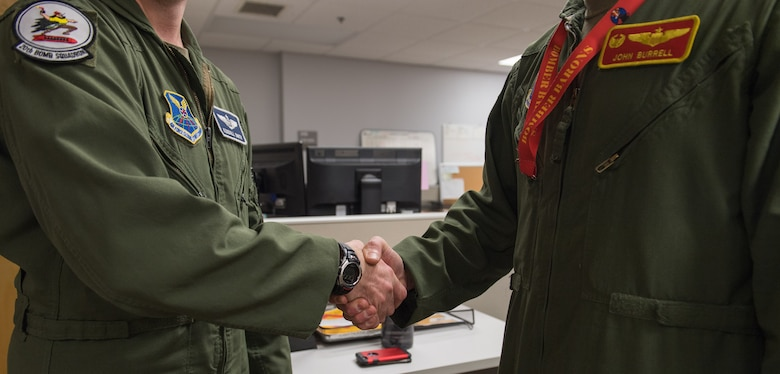 Capt. Kendall Smith (left), 20th Bomb Squadron assistant director of operations, and Lt. Col. John Burrell (right), 23rd Bomb Squadron commander, shake hands after training together at Barksdale Air Force Base, La., Nov. 21, 2019.