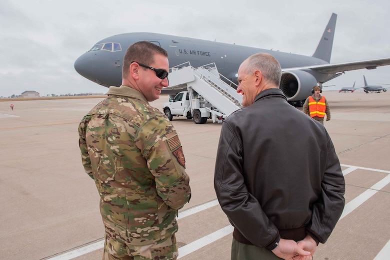 Col. Mark Baran, left, 22nd Air Refueling Wing vice commander, talks with Col. Eric Vitosh, 931st ARW vice commander, while waiting to welcome the aircrew who delivered McConnell's 17th KC-46 Pegasus Nov. 22, 2019, at McConnell Air Force Base, Kan. McConnell has 19 KC-46s, the Air Force's newest aircraft, which is the future of aerial refueling. (U.S. Air Force photo by Staff Sgt. Chris Thornbury)