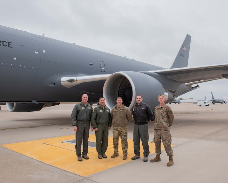 Brig. Gen. Darren V. James, left, Air Mobility Command KC-46 Pegasus Enterprise Lead, poses for a photo with the aircrew that delivered McConnell's 17th KC-46 Nov. 22, 2019, at McConnell Air Force Base, Kan. McConnell has 19 KC-46s, the Air Force's newest aircraft, which is the future of aerial refueling. (U.S. Air Force photo by Staff Sgt. Chris Thornbury)