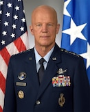 "Official portrait of Air Force Gen. John W. ""Jay"" Raymond, for his position as commander, Air Force Space Command, Peterson Air Force Base, Colo., taken Oct. 14, 2016.  U.S. Air Force photo."
