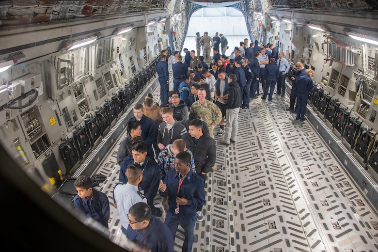 Students wait in line to see the flight deck of a C-17 Globemaster III Nov. 21, 2019, at Travis Air Force Base, California. Travis AFB hosted Junior Reserve Officer Training Corps students from five Northern California high schools and one Oregon high school. The students learned about various U.S. Air Force career fields and toured static aircraft, the Heritage Center museum and dormitories. They also talked with Airmen about military life. (U.S. Air Force photo by Heide Couch)