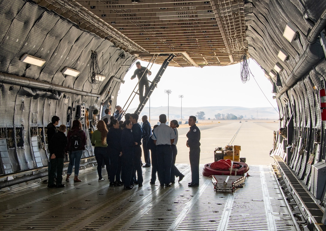 Students gain firsthand experience during a tour of a C-5 Super Galaxy during a base tour Nov. 21, 2019, at Travis Air Force Base, California. Travis AFB hosted Junior Reserve Officer Training Corps students from five Northern California high schools and one Oregon high school. The students learned about various U.S. Air Force career fields and toured static aircraft, the Heritage Center museum and dormitories. They also talked with Airmen about military life. (U.S. Air Force photo by Heide Couch)