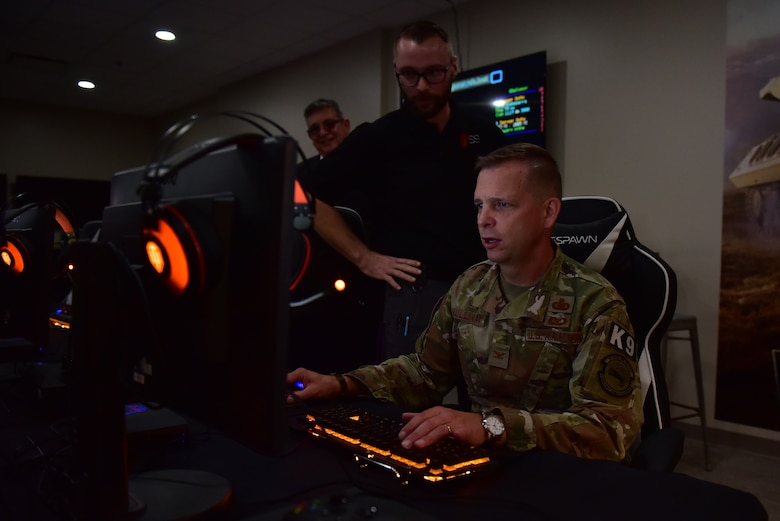 Col. Anthony Mullinax, 4th Mission Support Group commander, plays in the new USO of North Carolina center during the grand opening, Nov. 21, 2019, at Seymour Johnson Air Force Base, N.C. The USO of NC – SJAFB Center is home to the first USO E-Sports gaming arena, which includes 10 top-of-the-line gaming computers, gaming consoles and stations for guests who choose to bring their personal consoles. (U.S. Air Force photo by Senior Airman Victoria Boyton)