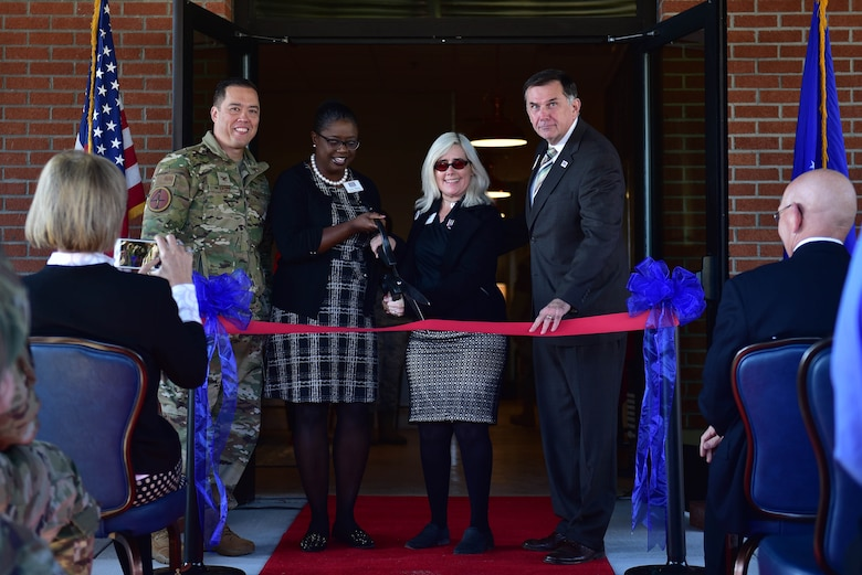 Col. Donn Yates, 4th Fighter Wing commander, left, along with members of the USO of North Carolina cut the ribbon during a ceremony marking the opening of a new USO of North Carolina center, Nov. 21, 2019, at Seymour Johnson Air Force Base, N.C. The new USO of NC – SJAFB Center will serve the more than 6,000 Airmen stationed on base, along with any other DOD ID card holder. (U.S. Air Force photo by Senior Airman Victoria Boyton)
