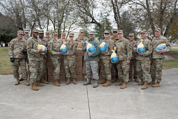 Team Seymour First Sergeants prepare to donate turkeys during Operation Warm Heart, Nov. 19, 2019, Seymour Johnson Air Force Base, N.C. Airmen throughout SJAFB were chosen by their leadership to receive a turkey and side dish items for Thanksgiving dinner. (U.S. Air Force Photo by Senior Airman Victoria Boyton)