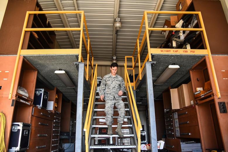 An Airman walks down the stairs.