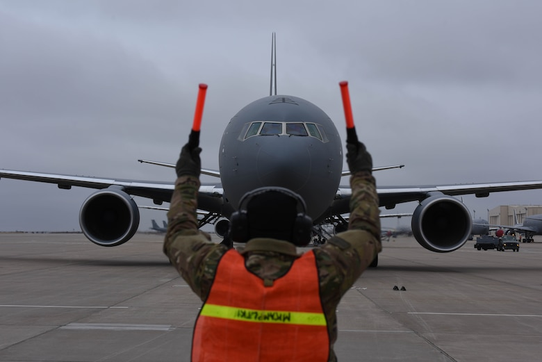 A 22nd Maintenance Group crew chief marshals in McConnell's 19th KC-46 Pegasus Nov. 22, 2019, at McConnell Air Force Base, Kan. McConnell will have a fleet of 36 KC-46s to lead the future of aerial refueling. (U.S. Air Force photo by Airman 1st Class Marc Garcia)