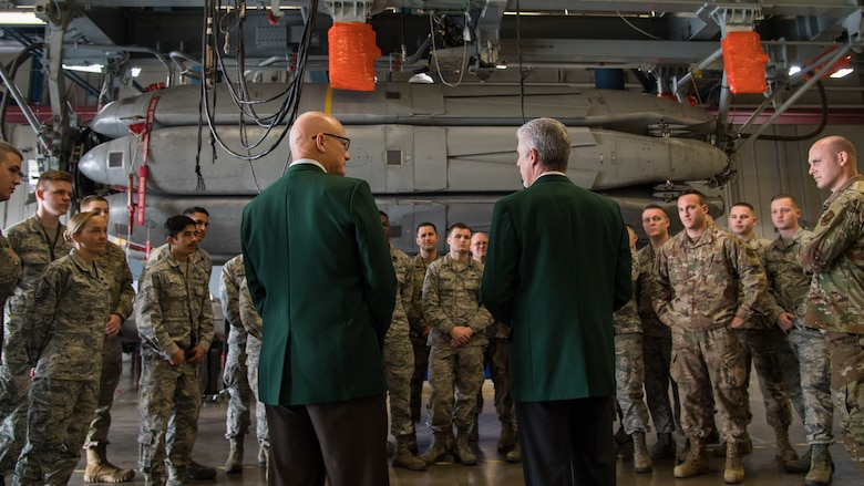 Retired Cols. Warren Ward (left) and Trey Morriss (right), members of Operation Secret Squirrel, speak to Airmen during the final download of the Conventional Air-Launched Cruise Missile (CALCM) package at Barksdale Air Force Base, La., Nov. 20, 2019. Operation Secret Squirrel was the first time CALCM missiles were used in combat. (U.S. Air Force photo by Airman 1st Class Jacob B. Wrightsman)