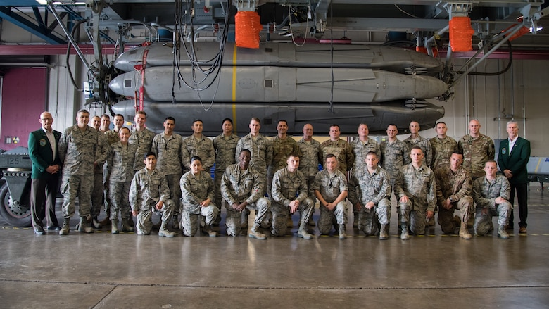 Airmen from the 2nd Munitions Squadron alongside retired Cols. Warren Ward (far left) and Trey Morriss (far right), members of Operation Secret Squirrel, pose in front of the final Conventional Air-Launched Cruise Missile (CALCM) package at Barksdale Air Force Base, La., Nov. 20, 2019. The CALCM missile package is being retired and replaced by more advanced Long-Range Stand-Off (LRSO) weapons. (U.S. Air Force photo by Airman 1st Class Jacob B. Wrightsman)