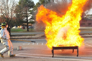 Photo of turkey fryer fire demonstration with cooking apparatus engulfed in flames.